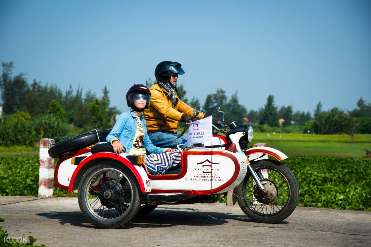 sidecar with driver and passenger in hoi an